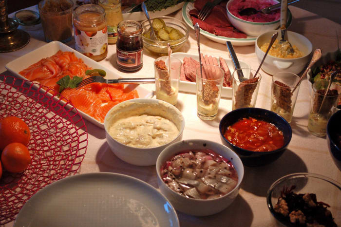 """Sweden also celebrates Christmas on the 24th. On the traditional Christmas dinner table you'll find ham, meatballs, sausages, spare ribs, different kinds of herring, lox, Jansson's temptation (a potato casserole with anchovies), red cabbage, brown cabbage, Brussels sprouts, some lye fish (very smelly), and in the south it's traditional to eat smoked eel. To top it off, you have Christmas porridge and an array of cookies and sweets. We also have a Christmas soda called Julmust.""Submitted by cefroberg"