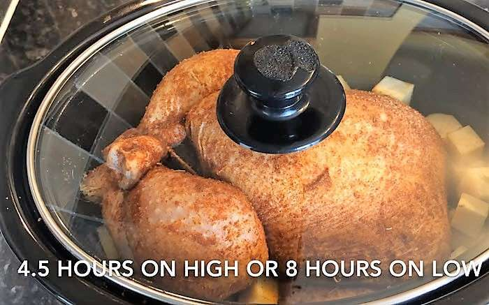 Slow Cooker Whole Roast chicken cover and cook on high or low as seen on SlowCookerSociety